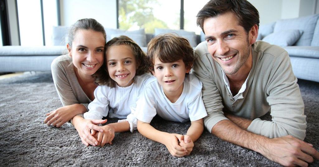 Family posing on carpet